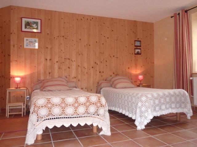Chambre sillon avec 4 lits simples
